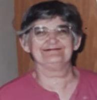 foto de uma senhora vestindo uma camiseta rosa, com óculos, mãe de pedro